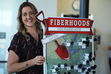 PUD 3's Terri Oberg shows off map of eligible Fiberhood communities in Mason County